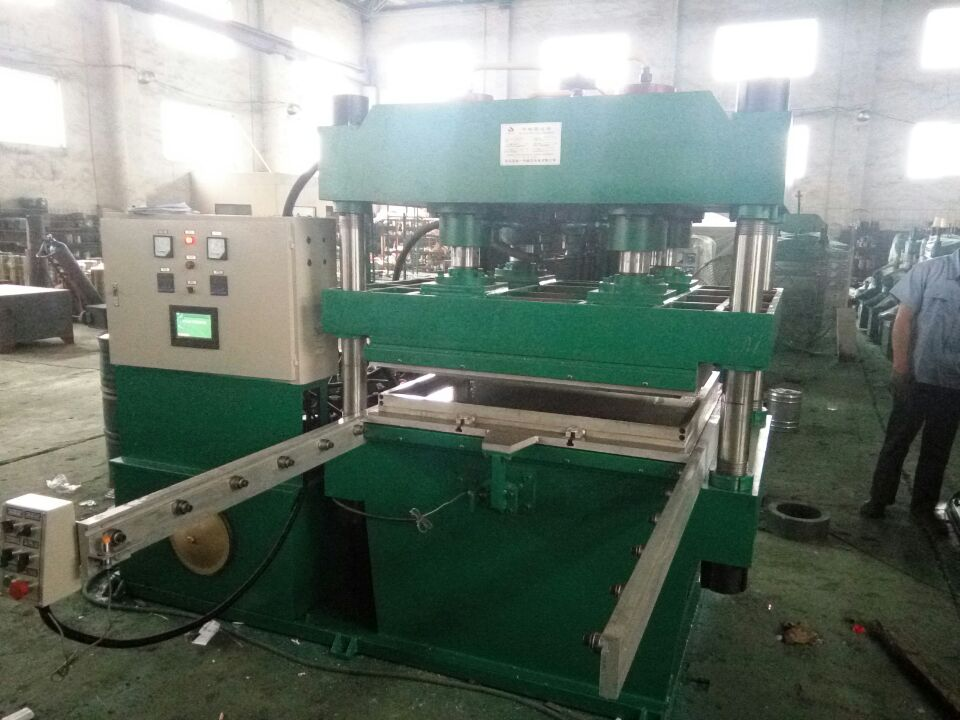 青岛鑫城一鸣上压式全自动橡胶垫平板硫化机 橡胶垫子地板硫化机